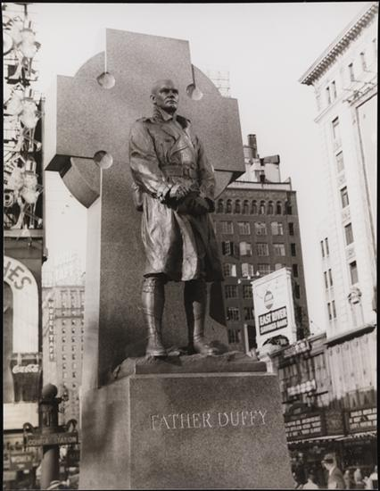 Carl Van Vechten (1880-1964). Statue of Father Duffy, Times Square, May 15, 1937. Museum of the City of New York. X2010.8.566 Image used with permission from the Van Vechten Trust.