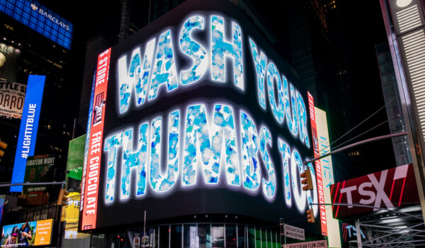 "Jenny Holzer's ""Wash Your Thumbs Too"" on the 20 Times Square screen"