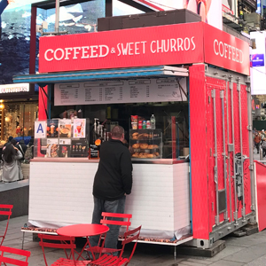 The COFFEED kiosk in Times Square, offering coffee and churros