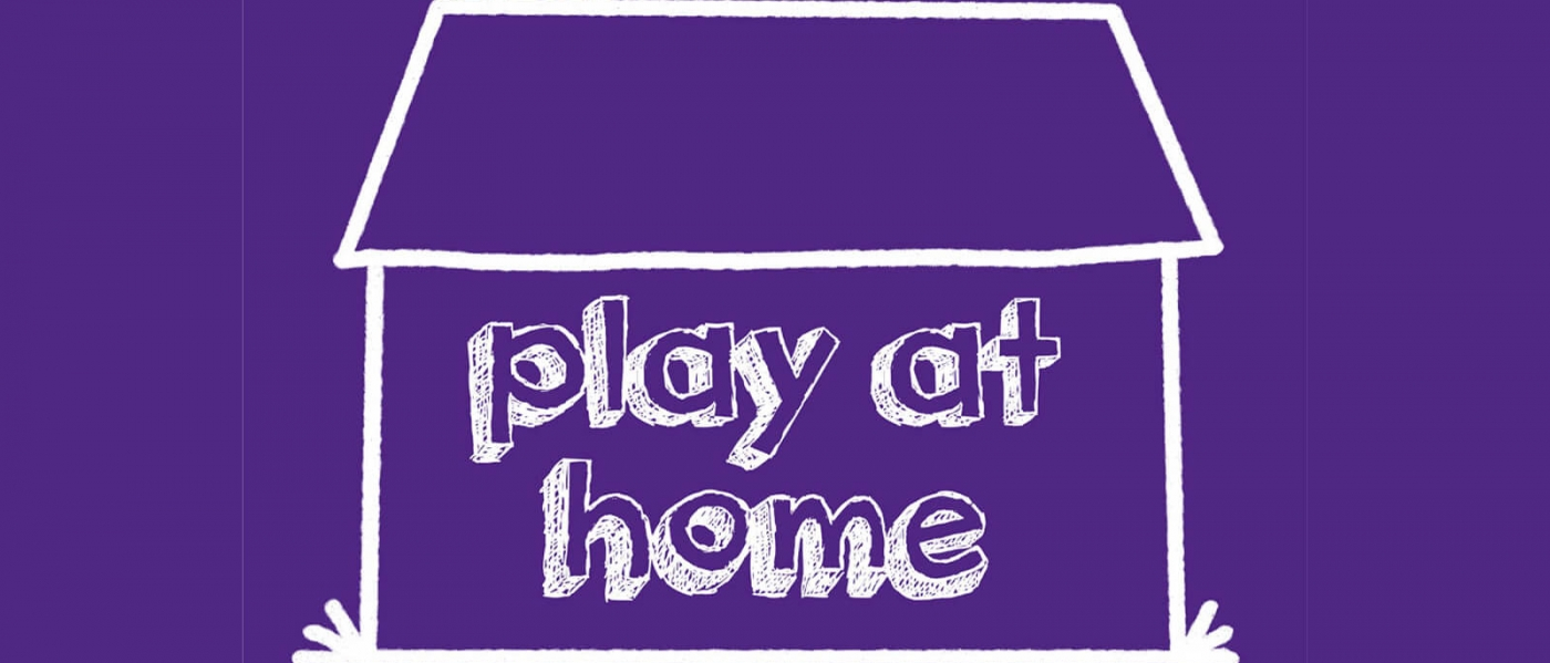 Simple outline of a house with text inside reading 'play at home'