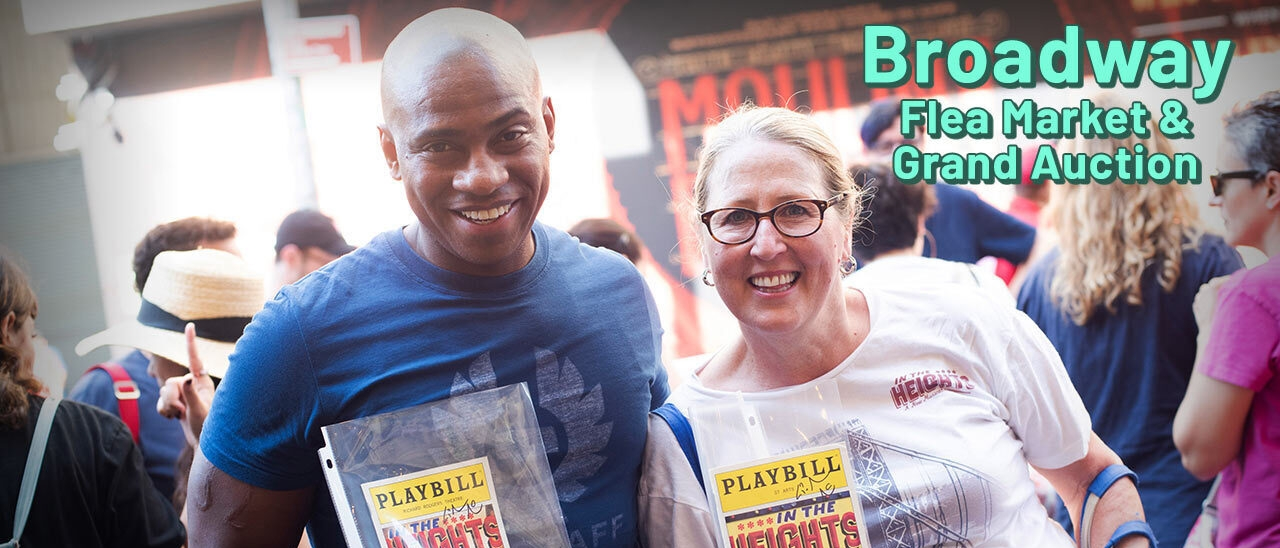 A man and woman holding signed playbills of In The Heights at a previous Broadway Flea Market event
