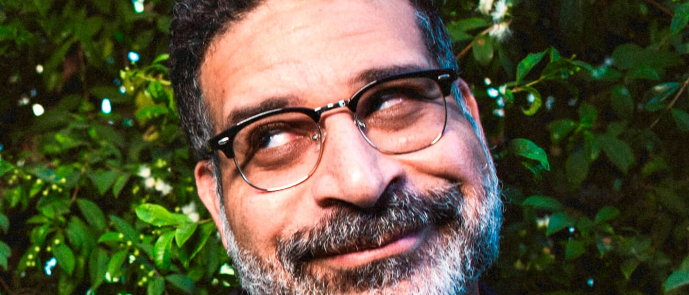 Erik Griffin rolling his eyes to the site while smiling slightly