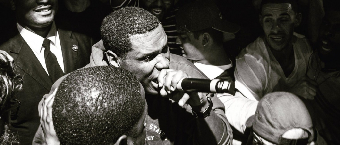Jay Electronica rapping into a microphone
