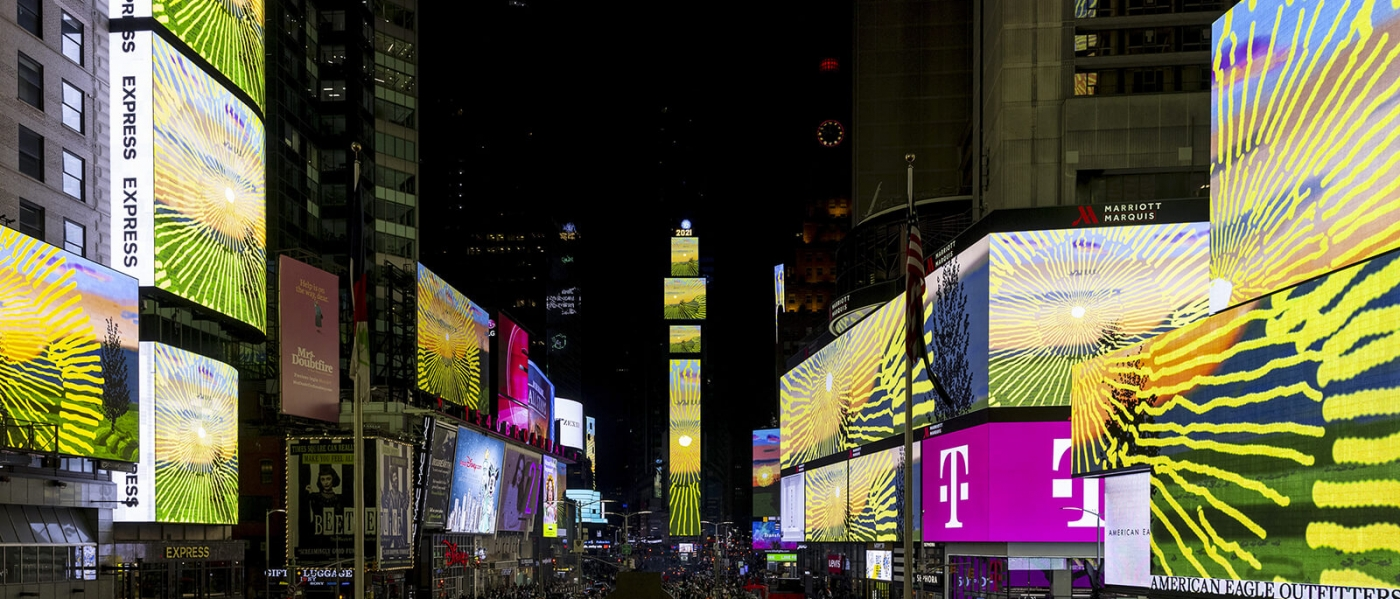 Remember you cannot look at the sun or death for very long, by David Hockney, on the screens of Times Square