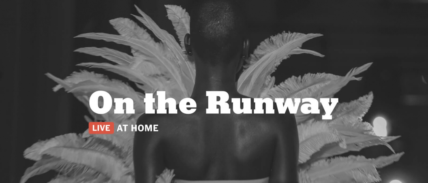 """A black and white photo of a Black model on a runway wearing a dramatic outfit that resembles feathers or leaves. Text above reads """"On the Runway: Live at Home"""" above a New York Times logo"""