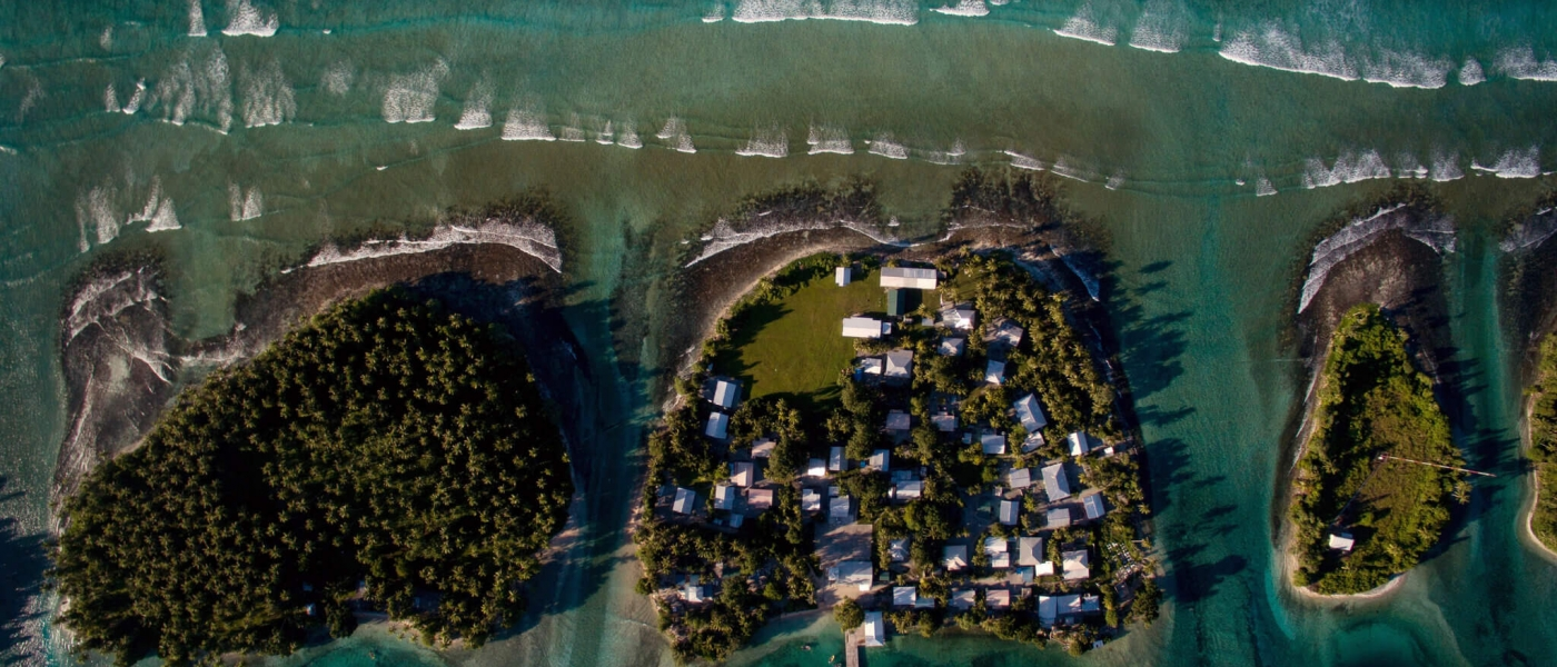 Forested islands with houses as seen from above