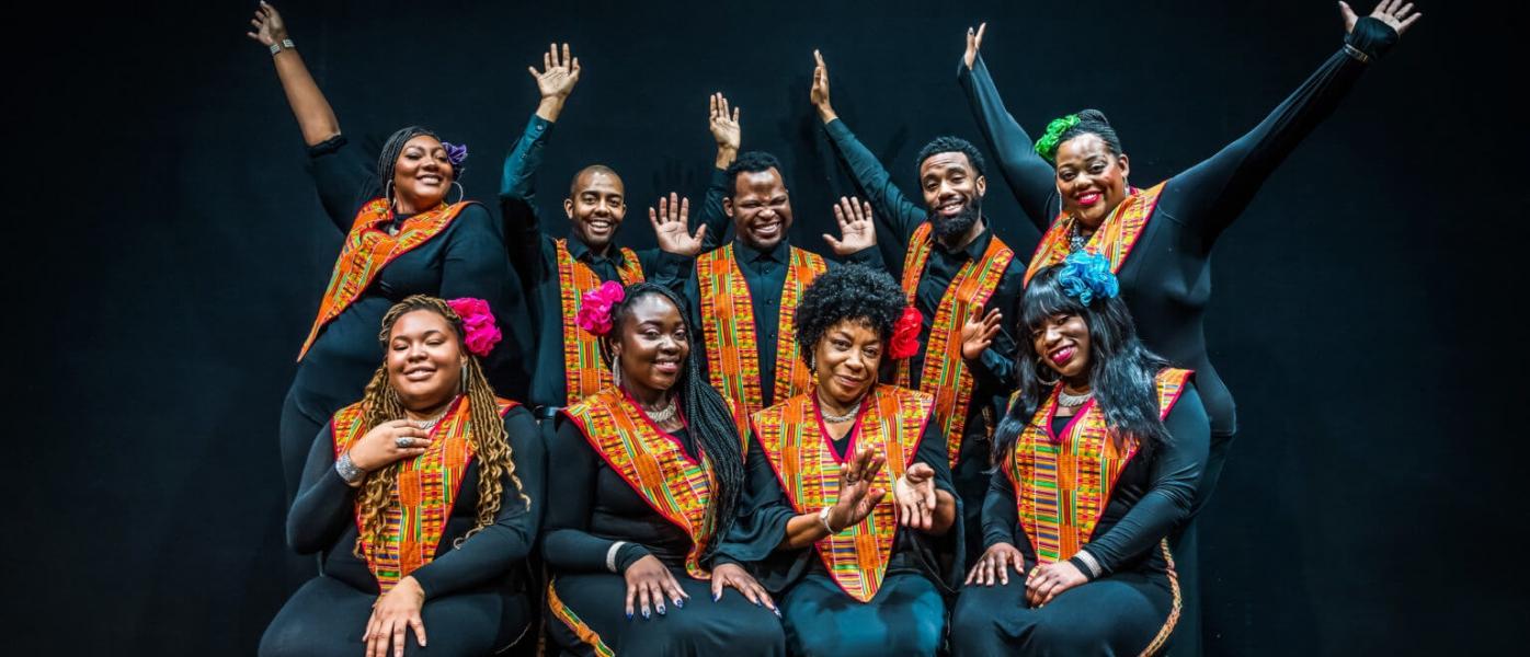 Members of the Harlem Gospel Choir pose joyously