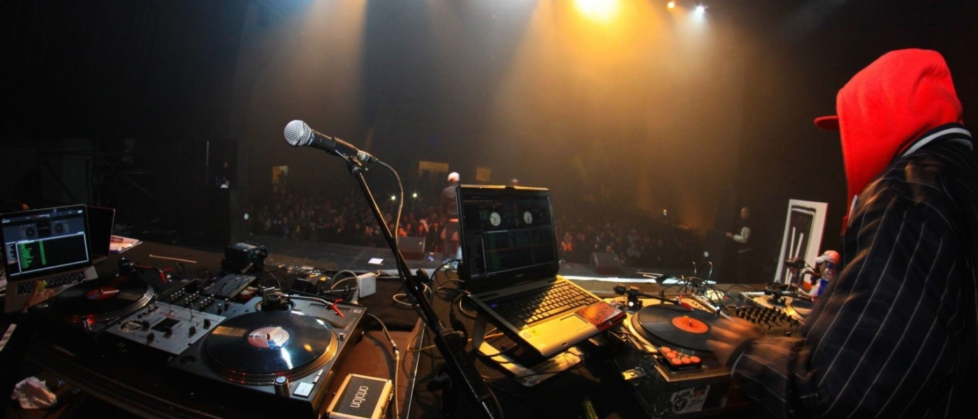 Photo showing a DJ setup and an audience at Sony Hall.
