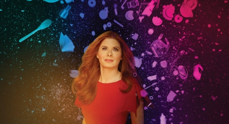 Debra Messing stands with a colorful background behind text reading